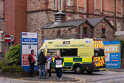 "© Licensed to London News Pictures . 13/10/2014 . Salford , UK . An ambulance responding to an emergency arrives at the hospital's A&E entrance . NHS staff picket outside the Salford Royal (formerly "" Hope "") Hospital in Greater Manchester as nurses, midwives and ambulance staff stage a four hour strike over pay .  Photo credit : Joel Goodman/LNP"
