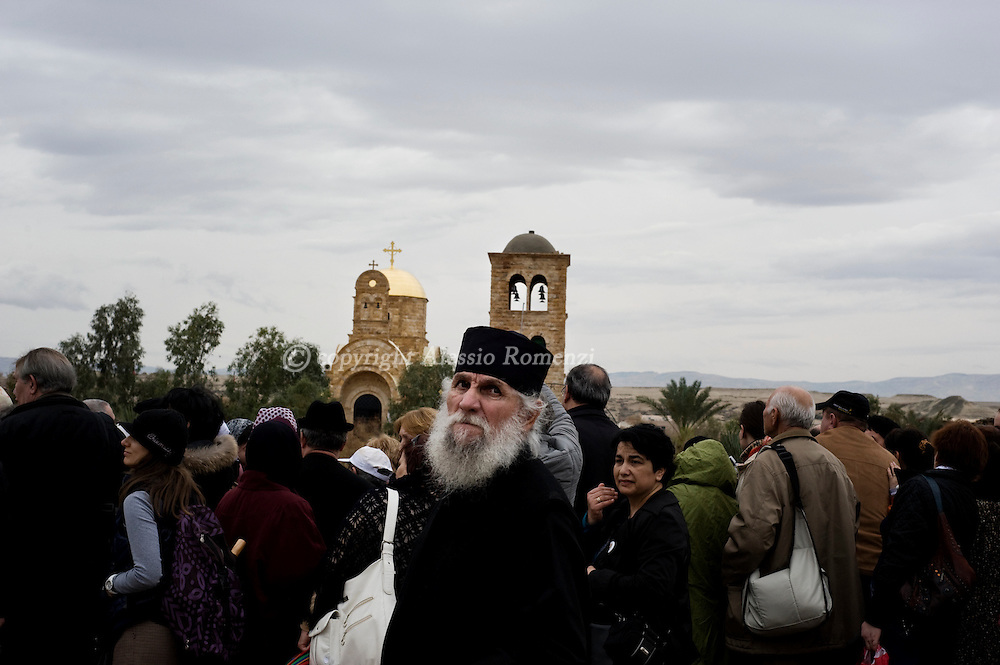 January 18, 2010 at the Qasr al-Yahud baptismal site in the West Bank. Thousands of Orthodox Christians braved rain on the banks of the Jordan river to plunge into plastic tubs filled with its murky water in a celebration of Jesus's baptism..© ALESSIO ROMENZI