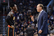 Jan 23, 2016; Phoenix, AZ, USA; Atlanta Hawks head coach Mike Budenholzer talks with guard Dennis Schroder (17) during the second half of the game against the Phoenix Suns at Talking Stick Resort Arena. The Suns won 98-95. Mandatory Credit: Jennifer Stewart-USA TODAY Sports