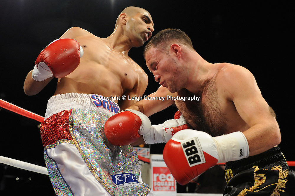Glenn Foot (black shorts) defeats Ali Sha in a 6x3 Welterweight contest at the Premier Suite, Reebok Stadium, Bolton, UK on 22.10.11. Frank Maloney Promotions. Photo credit: © Leigh Dawney.
