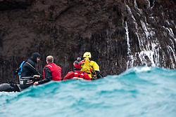 Nick Hancock (yellow) failing on the first try to get on Rockall, for his reconnaissance mission for a future 60 day occupation of Rockall. The Rockall Jubilee Expedition, a unique endurance expedition to be undertaken by Nick, in order to raise funds for Help for Heroes .©Michael Schofield..