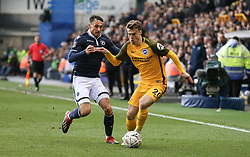 Solly March of Brighton and Hove Albion holds off a challenge from Lee Gregory of Millwall - Mandatory by-line: Arron Gent/JMP - 17/03/2019 - FOOTBALL - The Den - London, England - Millwall v Brighton and Hove Albion - Emirates FA Cup Quarter Final
