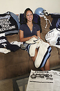 Brittnay Climmons sits with some of her sports equipment, Saturday, August 11, 2007.