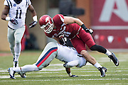 FAYETTEVILLE, AR - NOVEMBER 22:  AJ Derby #11 of the Arkansas Razorbacks is tackled in the second quarter by Tony Conner #12 of the Ole Miss Rebels at Razorback Stadium on November 22, 2014 in Fayetteville, Arkansas.  The Razorbacks defeated the Rebels 30-0.  (Photo by Wesley Hitt/Getty Images) *** Local Caption *** AJ Derby; Tony Conner
