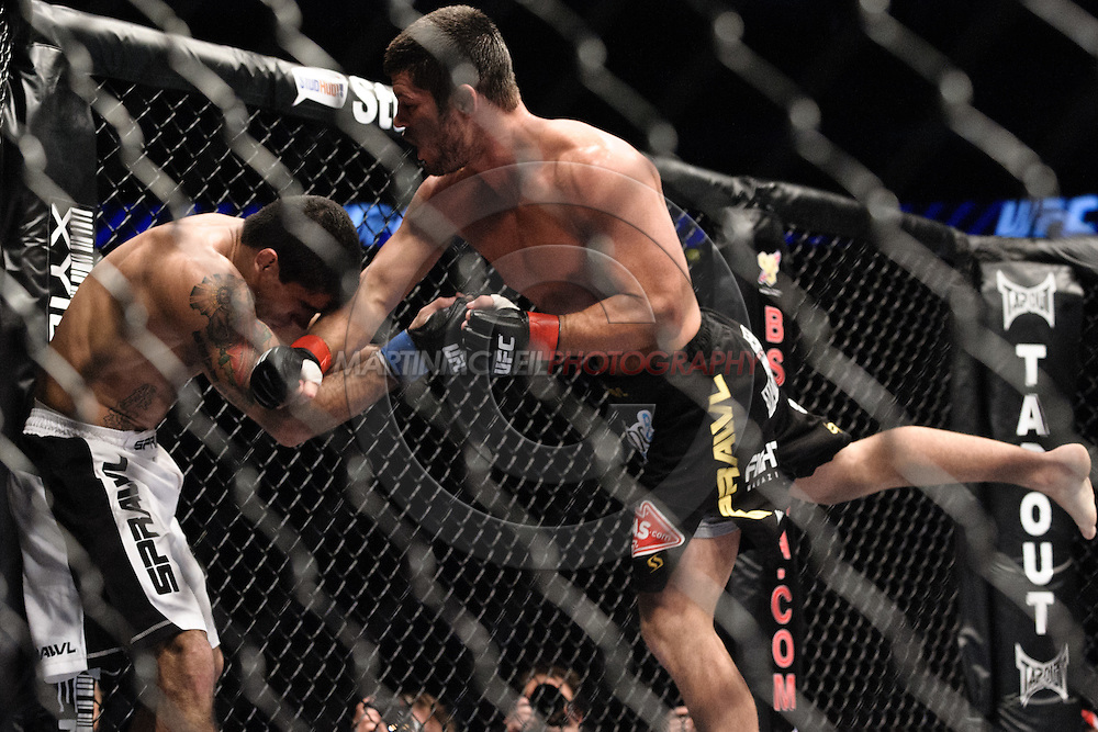 "LONDON, ENGLAND, JUNE 7, 2008: Thiago Tavares (left) is stunned by a lunging punch from Matt Wiman during ""UFC 85: Bedlam"" inside the O2 Arena in Greenwich, London on June 7, 2008."