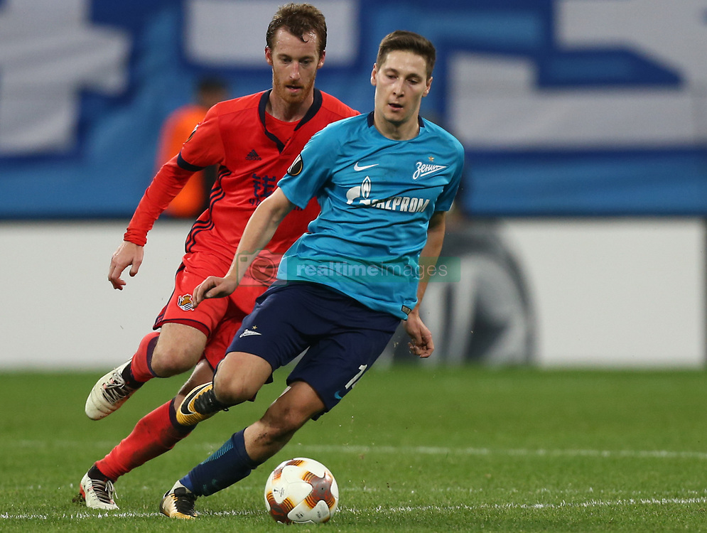 September 28, 2017 - Saint Petersburg, Russia - David Zurutuza of FC Real Sociedad (L) and Daler Kuzyaev of FC Zenit Saint Petersburg vie for the ball during the UEFA Europa League Group L football match between FC Zenit Saint Petersburg and FC Real Sociedad at Saint Petersburg Stadium on September 28, 2017 in St.Petersburg, Russia. (Credit Image: © Igor Russak/NurPhoto via ZUMA Press)
