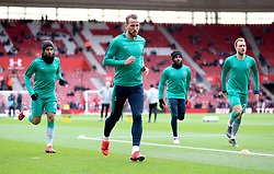 Tottenham Hotspur's Harry Kane (centre) during the pre-match warm up prior to the beginning of the Premier League match at St Mary's Stadium, Southampton.