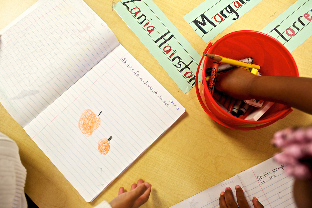 """Pre-kindergarten students at Calvin Rodwell Elementary School No. 256 in Baltimore, MD, write and draw what they think they'll see at a farm after they read the book """"A Day at the Pumpkin Patch,"""" a non-fiction children's book about visiting a farm. The book was part of a """"Common Core"""" reading and learning unit, which aims to follow up non-fiction reading with learning in the field. The day after the children read the book about the farm, they visited Summers Farm in Frederick, MD."""