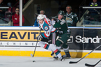 KELOWNA, CANADA - JANUARY 24: Brayden Low #11 of Everett Silvertips checks Justin Kirkland #23 of Kelowna Rockets during second period on January 24, 2015 at Prospera Place in Kelowna, British Columbia, Canada.  (Photo by Marissa Baecker/Shoot the Breeze)  *** Local Caption *** Justin Kirkland; Brayden Low;