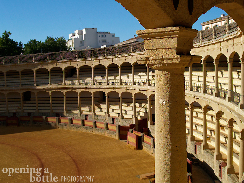A stone pillar and the arcades of the grandstands at the Ronda Bullring, Ronda (Andalusia), Spain. It is said that this bullring is the birthplace of modern bull fighting.