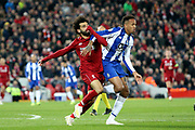 FC Porto defender Eder Militao (3) and Liverpool forward Mohamed Salah (11) tangle during the Champions League Quarter-Final Leg 1 of 2 match between Liverpool and FC Porto at Anfield, Liverpool, England on 9 April 2019.