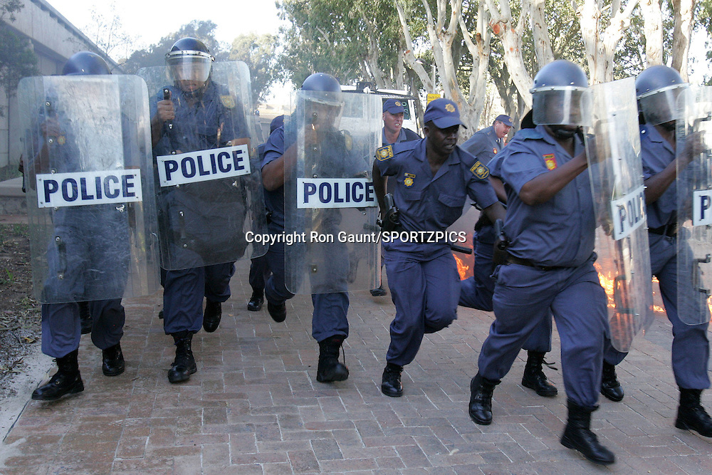 Cape Town South Africa. Police officers face another petrol bomb attack during the South African Police Service (SAPS) crowd and riot control training sessions held in and around Cape Town Stadium in preparation for the FIFA 2010 World Cup being held in South Africa in 2010..Photo by: RG/sportzpics.net