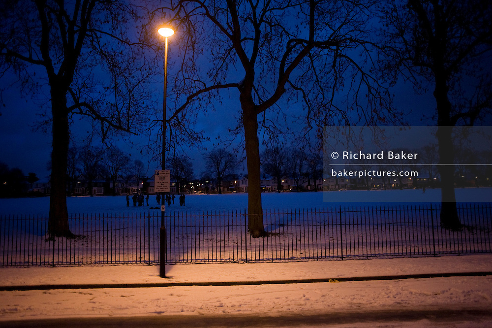 Warm light from a London street lamp against blue chilly light during the early 2010 snows that gripped the UK.