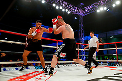 Young Fury (brother of Tyson Fury, burgundy shorts) on his way to a points victory over Jindrich Velecky (black shorts) in a Heavyweight bout on the undercard - Photo mandatory by-line: Rogan Thomson/JMP - 07966 386802 - 13/06/2015 - SPORT - BOXING - Bristol, England - Action Indoor Sports Arena - Lee Haskins vs Ryosuke Iwasa - Interim IBF World Bantamweight Title Fight - UNDERCARD.