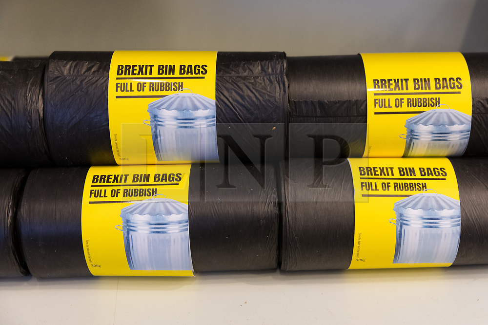 © Licensed to London News Pictures. 23/11/2018. London, UK.  'Brexit Bin Bags' rubbish bags on a shelf inside the People's Vote campaign stunt pop-up shop in Peckham High Street on Black Friday to show that the government's Brexit deal is a bad deal and the shop is stocked with household products, such as 'chlorinated' chicken to illustrate the bad deal. Photo credit: Vickie Flores/LNP