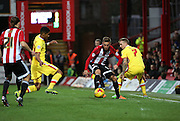 Milton Keynes Dons defender Jordan Spence sliding in to tackle the bal during the Sky Bet Championship match between Brentford and Milton Keynes Dons at Griffin Park, London, England on 5 December 2015. Photo by Matthew Redman.