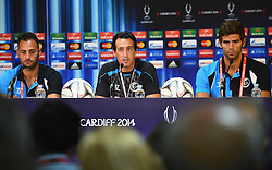 CARDIFF, WALES - Tuesday, August 12, 2014: Sevilla's goalkeeper Keylor Navas, head coach Unai Emery and Federico Fazio during a press conference ahead of the UEFA Super Cup at Cardiff City Stadium.  (Pic by Pool/Getty Images/Propaganda)