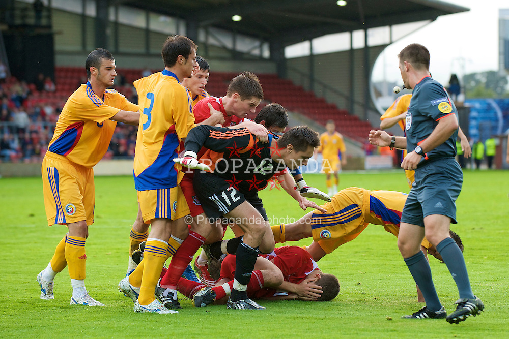 WREXHAM, WALES - Wednesday, August 20, 2008: Wales' Ched Evans goes down after being struck by Romania's Stefan Radu during the UEFA Under 21 European Championship Qualifying Group 10 match at the Racecourse Ground. (Photo by David Rawcliffe/Propaganda)