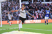 Derby County forward Martyn Waghorn (9) shoots, scores and celebrates his goal 2-0 during the EFL Sky Bet Championship match between Derby County and Birmingham City at the Pride Park, Derby, England on 28 September 2019.