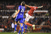 Nottingham Forest defender Armand Traore (6) clashes with Birmingham City forward Lukas Jutkiewicz (15) in the air during the EFL Sky Bet Championship match between Nottingham Forest and Birmingham City at the City Ground, Nottingham, England on 14 October 2016. Photo by Jon Hobley.