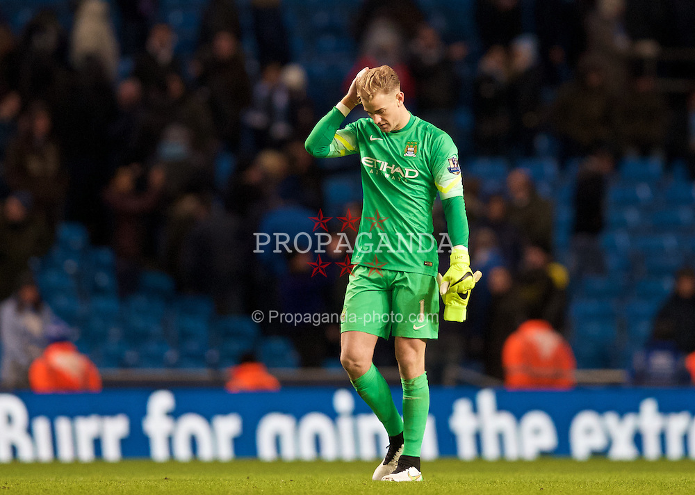 MANCHESTER, ENGLAND - Sunday, January 18, 2015: Manchester City's goalkeeper Joe Hart looks dejected after his side's 2-0 defeat against Arsenal during the Premier League match at the City of Manchester Stadium. (Pic by David Rawcliffe/Propaganda)
