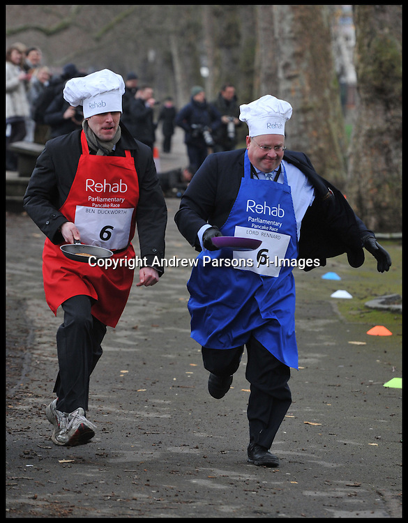 Total Politics editor Ben Duckworth (left) and Lord Rennard take part in the MP's and Lords race against political Journalist in the Rehab Parliamentary Pancake Shrove Tuesday race a charity event which sees MPs and Lords joined by media types in a race to the finish. Victoria Tower Gardens, Westminster, Tuesday February 12, 2013. Photo By Andrew Parsons / i-Images<br /> File photo - Lord Rennard Suspended.<br /> Lib Dems suspend Lord Rennard for refusing to apologise for sex harassment claims minutes before he took seat in Lords.<br /> Photo filed Monday 20th January 2014.