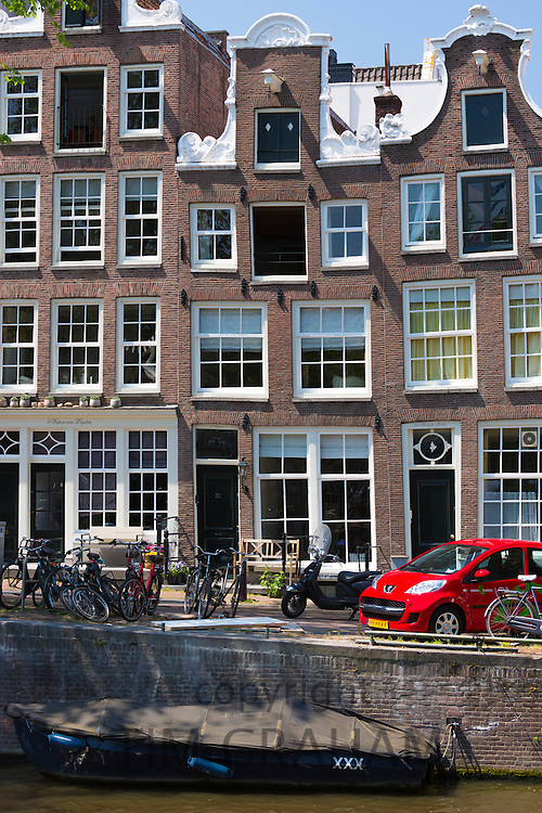 Canalside ornate gabled houses - Dutch gables - on Herengracht in Jordaan District of Amsterdam, Holland