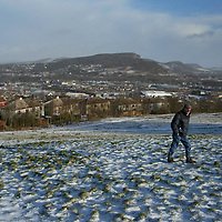 A man takes a walk on Craigie Hill overlooking Perth. The predicted bad weather has avoided the area with only a light dusting of snow. Pictured right is the Friarton Bridge and the hill picture centre is Kinnoull Hill.<br />