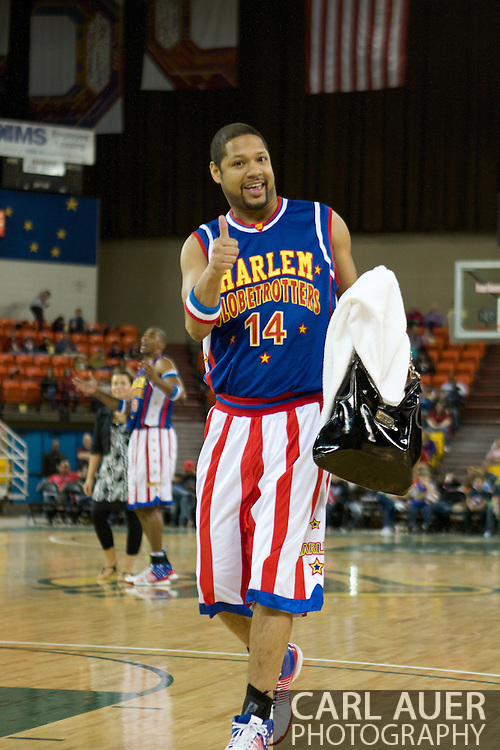 April 30th, 2010 - Anchorage, Alaska:  Purse snatching Globetrotter Handles Franklin (14) makes off with a fans purse while Hi-Lite Bruton distracts the purse owner at mid-court.