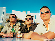 Three guys staring into the distance drinking spanish beer, Ibiza, 2000