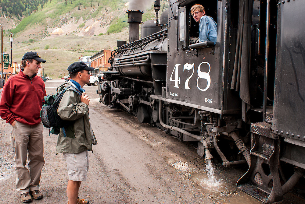 The Durango Silverton Railroad make a scheduled stop in downtown Silverton, engineers make preparations for the return trip south in Cascade Canyon and on to Durango, Colorado.