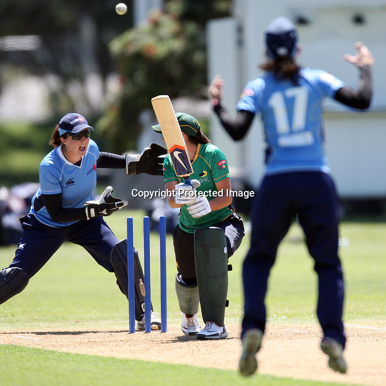 Sara McGlashan is bowled by Paula Gruber. Women's One Day Cricket, Action Cricket Cup, Auckland Hearts v Central Hinds, Melville Park, Auckland, Saturday 8 January 2011, . Photo: Ella Brockelsby/photosport.co.nz
