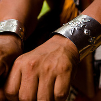 Metal carved bracelets made by a young emberá in the Chagres River.  The Emberás are one of the seven indigenous groups still present in Panama.  They are usually find by the Chagres River in the Panama Canal protected areas as well as in the mountains and rivers of the Darien jungle