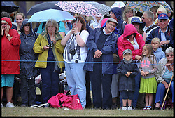 Royal fans wait in the rain for the arrival of HRH The Prince Of Wales and The Duchess of Cornwall at Sandringham Flower Show<br /> Sandringham, Norfolk, United Kingdom<br /> Wednesday, 31st July 2013<br /> Picture by Andrew Parsons / i-Images