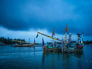 29 JULY 2017 - AIRKUNING, BALI, INDONESIA: Small trawlers in port in Kuning, a Muslim fishing village on the southwest corner of Bali. A lot of the fishing is done from small outrigger canoes that stay out overnight. Villagers said their regular catch of fish has been diminishing for several years, and that are some mornings that they come back to shore with having caught any fish.    PHOTO BY JACK KURTZ