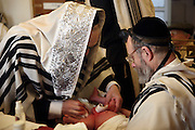 On the 8th day after birth a Brit Milah (Circumcision) is performed on a Jewish baby boy (unless there is a medical reason to delay it). The ceremony takes place in the synagogue and the man who carries out the skin removal is know as a Mohel and is medically trained, the boy is also given his Hebrew and/or English names. Here the father and grandfather of the baby boy assist the Mohel, friends and family attend the ceremony.