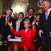 Governor Chris Gregoire celebrates with legislators after signing a bill legalizing gay marriage in Washington State on Monday February 13, 2012 at the Legislative Building of the Washington State Capitol in Olympia. At left is State Representative Jamie Pedersen and at right is Senator Ed Murray. (Joshua Trujillo, seattlepi.com)