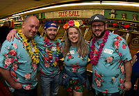 """""""Team Amoskeag""""  John Valliere, Adam Smith, Makenzie White and Chuck Taggett show their festive spirit as they get ready to take on a game of Skee Ball during the annual NH Humane Society Indoor Triathlon at Funspot on Saturday.  (Karen Bobotas/for the Laconia Daily Sun)"""