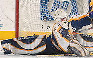 3/12/05 Omaha, Neb. Lake Superior State goalie Jeff Jakaitis can't stop a first period Brandin Scero shot Saturday night in Qwest Center Omaha. This was the first gamein the CCHA play-off.(photo by chris machian/Prarie Pixel Group)