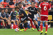 Chris Rolfe scored a pair of goals in the second half to lead D.C. United to an important 2-1 win over the New England Revolution at steamy RFK Stadium. With the win, the Black-and-Red extend their lead in the Eastern Conference to seven points.