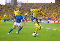 Italy v Sweden - Estadio Dragao, Porto - 18th June 2004<br />Italy's Sweden's Freddie Ljungberg back heels the ball in the penalty area deceiving Italy's Fabio Cannavaro<br />Photo: Jed Leicester/Sporting Pictures<br />© Sporting Pictures (UK) Ltd<br />www.sportingpictures.com<br />Tel: +44 (0)20 7405 4500<br />Fax: +44 (0)20 7831 7991