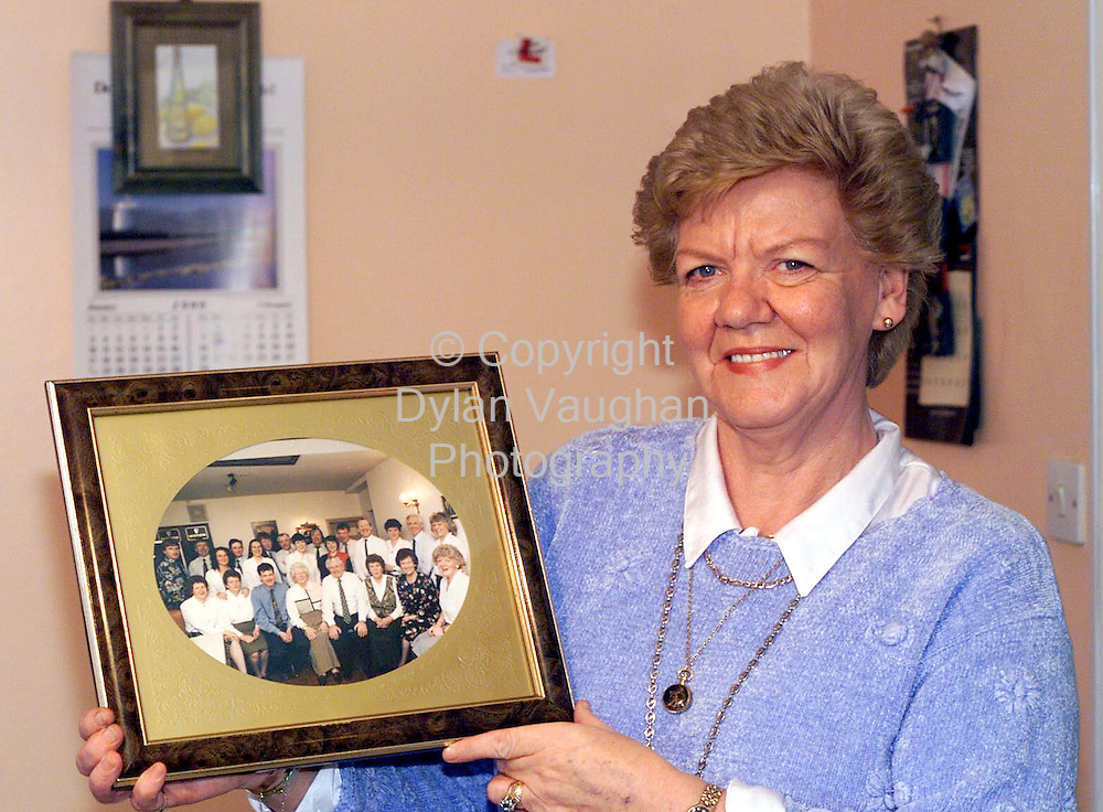 22/1/99 NEWS OF THE WORLD.PAULINE ARCHBOLD PICTUREDAT HER HOME IN ATHY WITH A PICTURE OF HER  MOTHER MARY AND HER 10 SISTERS AND 10 BROTHERS TAKEN IN 1996 AT HER HER MOTHERS 70TH BIRTHDAY PARTY.PICTURE DYLAN VAUGHAN