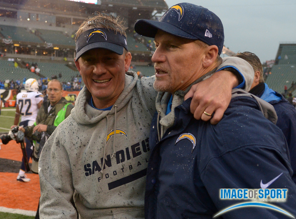 Jan 5, 2014; Cincinnati, OH, USA; San Diego Chargers coach Mike McCoy (left) embraces offensive coordinator Ken Whisenhunt after the 2013 AFC wild card playoff football game against the Cincinnati Bengals at Paul Brown Stadium.