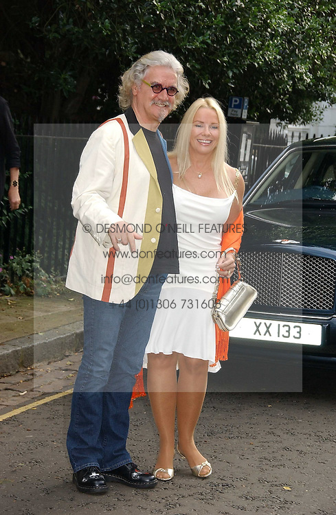 Comedian BILLY CONNOLLY and his wife PAMELA STEPHENSON at Sir David &amp; Lady Carina Frost's annual summer party held in Carlyle Square, Chelsea, London on 5th July 2006.<br />