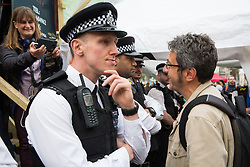 London, UK. 23rd April 2019. Writer and environmental activist George Monbiot is interviewed across a police cordon as Metropolitan Police officers surround a truck used as a stage by climate change activists from Extinction Rebellion at Marble Arch.