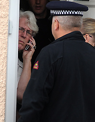 © Licensed to London News Pictures. 12/09/2013. Diane Ash-Smith (left), mother of Colin Ash-Smith, who was questioned in the past about the unsolved murder of Claire Tiltman, speaking to police on her doorstep. Police Raid a property in Stone, Dartford in connection with Claire Tiltman MURDER 20 YEARS AGO. Miss Tiltman was stabbed to death in an alleyway off the A226 London Road in Greenhithe, four days after her 16th birthday in 1993. Photo credit :Grant Falvey/LNP