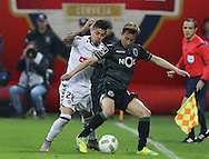 Nacional´s player Willyan (L ) fights for the ball with Sporting's player João Pereira   (R ) during Portuguese First League football match Nacional vs Sporting held at Madeira Stadium, Funchal, Portugal, 13 February, 2016.  LUSA / GREGÓRIO CUNHA