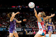 SYDNEY, AUSTRALIA - AUGUST 24: Caitlyn Nevins of the Queensland Firebirds passes the ball during the round 14 Super Netball match between the Swifts and the Queensland Firebirds at Qudos Bank Arena on August 24, 2019 in Sydney, Australia.(Photo by Speed Media/Icon Sportswire)
