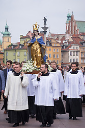 © Licensed to London News Pictures. 26/04/2016. Warsaw, Poland. Members of the Catholic Church taking part in a procession through Warsaw's Old Town in commemoration Corpus Christi (Boze Cialo). Corpus Christi (Body of Christ) is a Catholic feast celebrated as a national public holiday in Poland. It is the day when the Catholic Church commemorates the practice of Holy Eucharist, or Communion. Photo credit: Rob Arnold/LNP