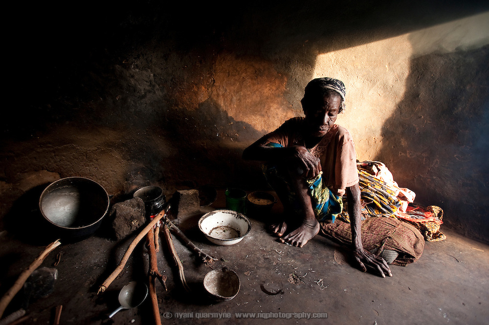 A resident of the Gambaga camp for alleged witches prepares her morning meal.